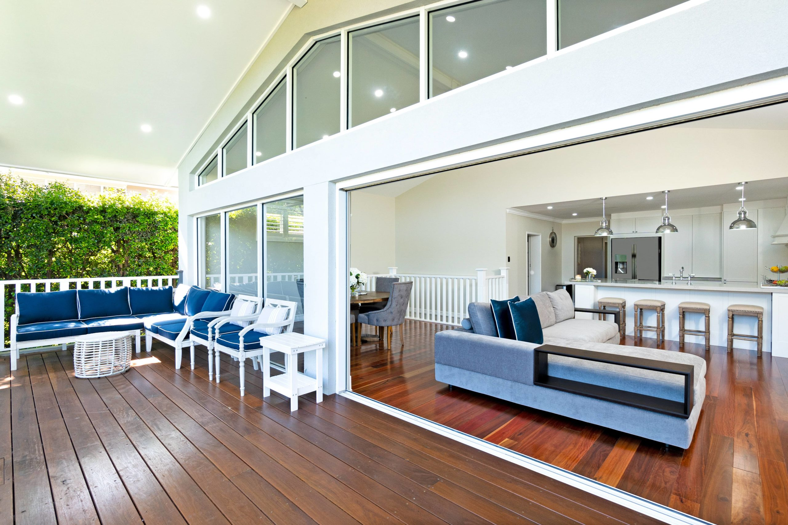 Indoor outdoor living with living area and deck