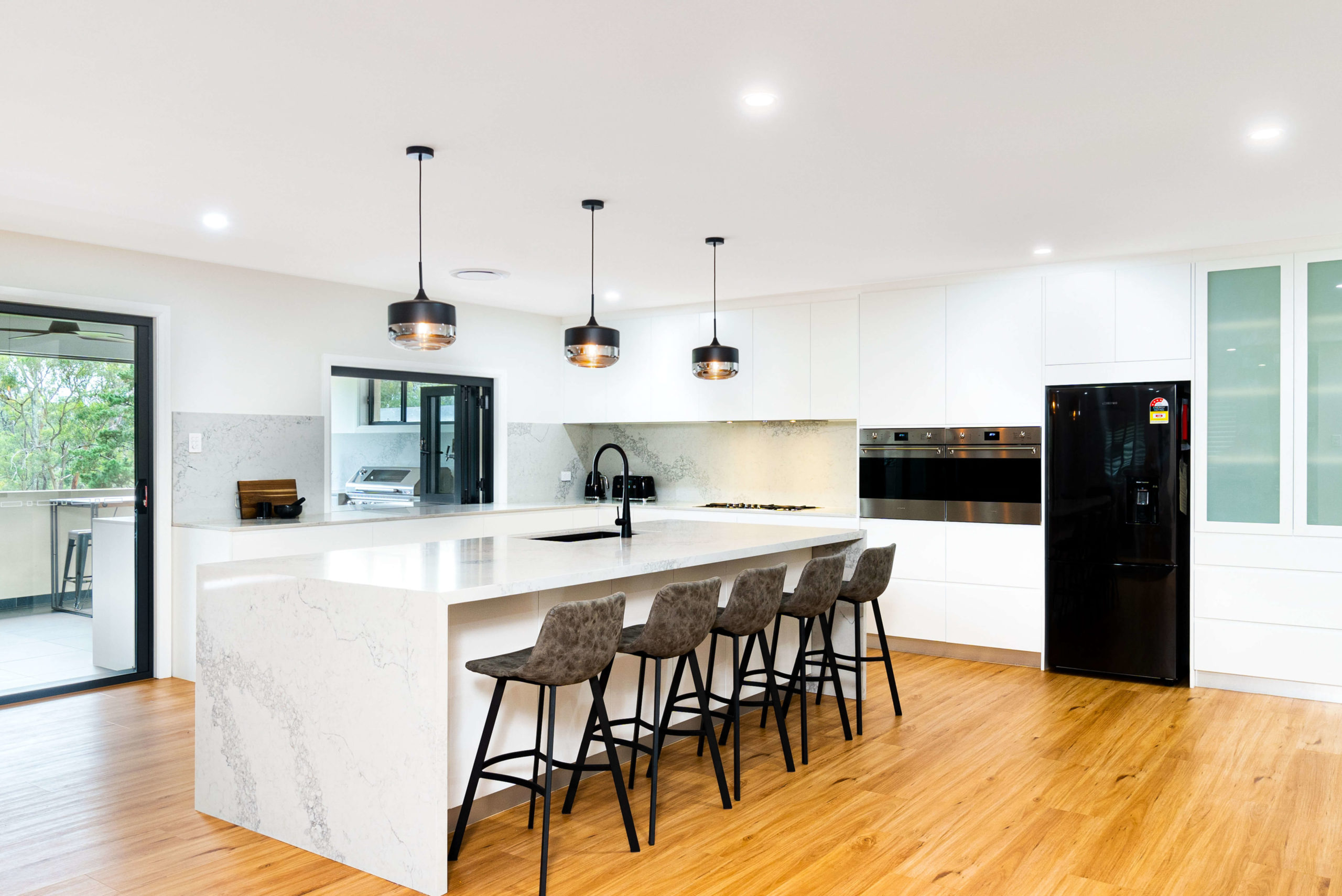 kitchen image with stools and benchtop